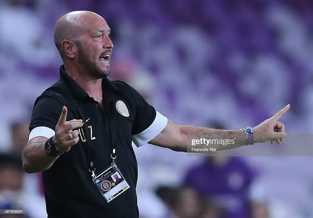 <a gi-track='captionPersonalityLinkClicked' href=/galleries/search?phrase=Walter+Zenga&family=editorial&specificpeople=891748 ng-click='$event.stopPropagation()'>Walter Zenga</a> coach of Al Jazira reacts during the Arabian Gulf League match between Al Ain Football Club and Al Jazira Football Club at Hazza bin Zayed Stadium on May 1, 2014 in Al Ain, United Arab Emirates.
