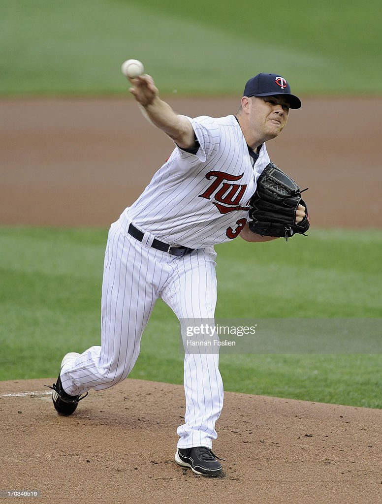 P.J. Walters #39 of the Minnesota Twins delivers a pitch against the Philadelphia Phillies during the first inning of the game on June 11, 2013 at Target Field in Minneapolis, Minnesota.