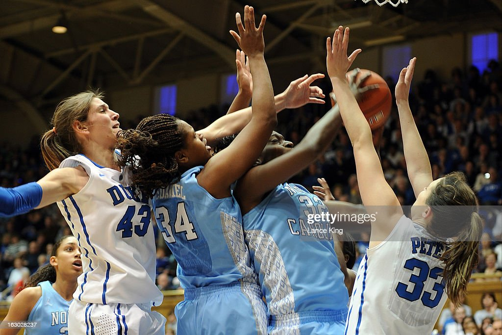 Waltiea Rolle #32 and Xylina McDaniel #34 of the North Carolina Tar Heels fight for a rebound against Allison Vernerey #43 and Haley Peters #33 of the Duke Blue Devils at Cameron Indoor Stadium on March 3, 2013 in Durham, North Carolina. Duke defeated North Carolina 65-58.