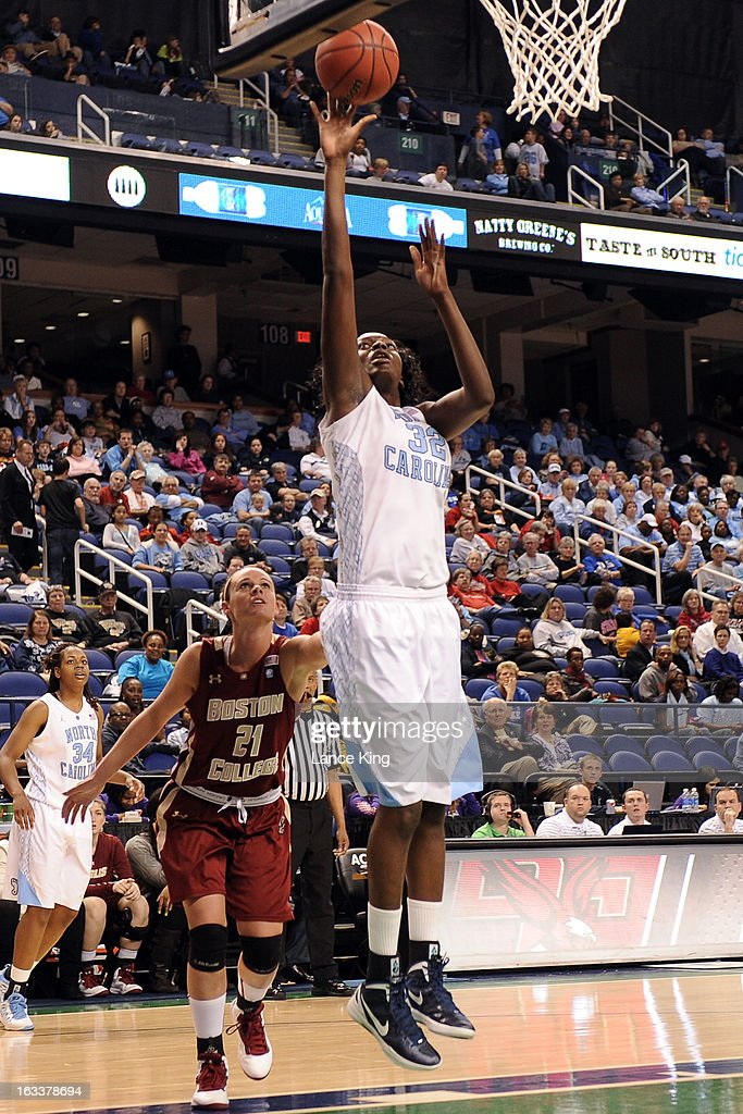 Waltiea Rolle #32 of the North Carolina Tar Heels puts up a shot against Kristen Doherty #21 of the Boston College Eagles during the quarterfinals of the 2013 Women's ACC Tournament at the Greensboro Coliseum on March 8, 2013 in Greensboro, North Carolina.