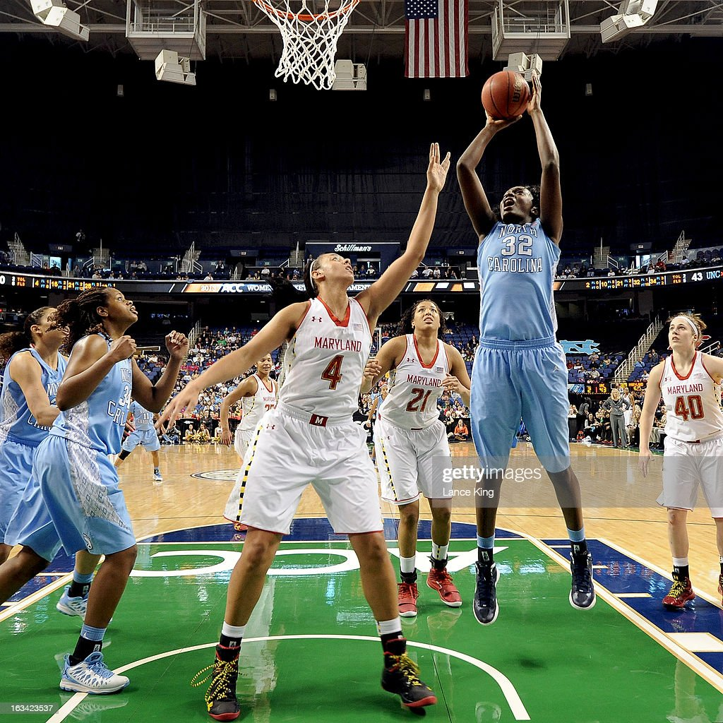Waltiea Rolle #32 of the North Carolina Tar Heels puts up a shot against Malina Howard #4 of the Maryland Terrapins during the semifinals of the 2013 Women's ACC Tournament at the Greensboro Coliseum on March 9, 2013 in Greensboro, North Carolina.