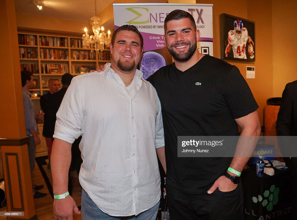 JD Walton and <a gi-track='captionPersonalityLinkClicked' href=/galleries/search?phrase=Justin+Pugh&family=editorial&specificpeople=7204721 ng-click='$event.stopPropagation()'>Justin Pugh</a> attend the Draft Classic Schuyler Gifting Suite at a private residence on May 6, 2014 in New York City.