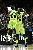 J Walton and Quincy Miller of the Baylor Bears show camaraderie in the second half of the game against the Colorado Buffaloes during the third round...