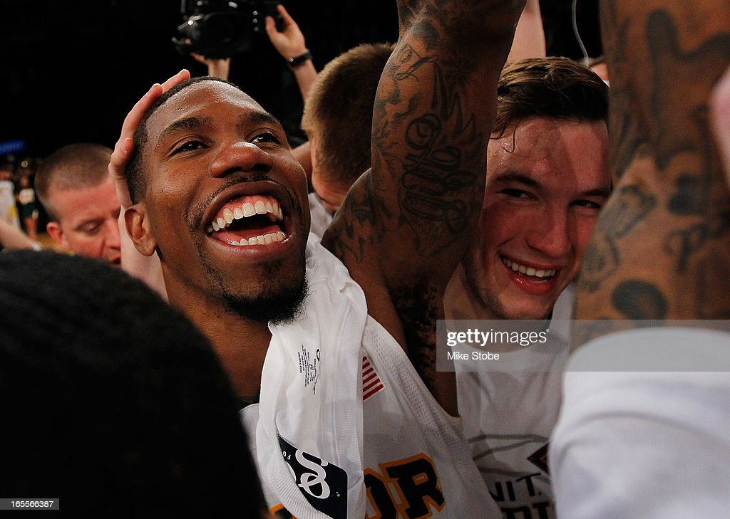 A.J. Walton #22 of the Baylor Bears celebrates after defeating the Iowa Hawkeyes during the 2013 NIT Championship at Madison Square Garden on April 4, 2013 in New York City. Baylor defeated Iowa 74-54.