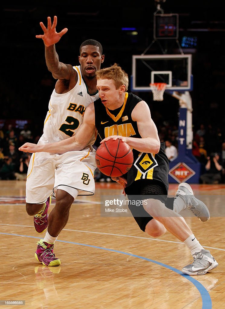 A.J. Walton #22 of the Baylor Bears defends against Mike Gesell #10 of the Iowa Hawkeyes during the 2013 NIT Championship at Madison Square Garden on April 4, 2013 in New York City. Baylor defeated Iowa 74-54.