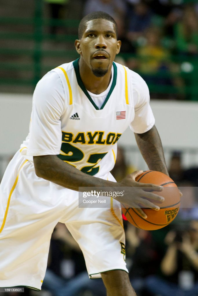 A.J. Walton #22 of the Baylor University Bears brings the ball up the court against the University of Texas Longhorns on January 5, 2013 at the Ferrell Center in Waco, Texas.