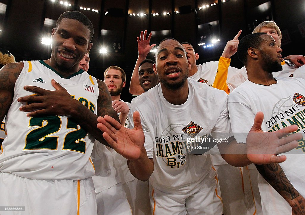 A.J. Walton #22, Rico Gathers #2 and Pierre Jackson #55 of the Baylor Bears celebrates after defeating the Iowa Hawkeyes during the 2013 NIT Championship at Madison Square Garden on April 4, 2013 in New York City. Baylor defeated Iowa 74-54.