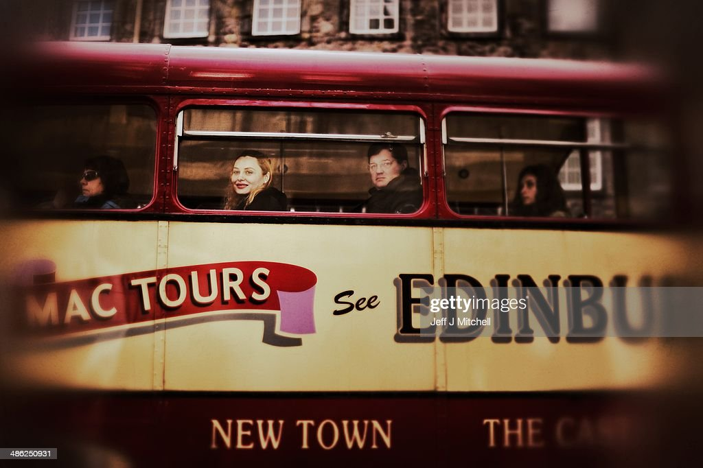 A waman smiles as she looks from a tourist bus on the Royal Mile on April 23, 2014 in Edinburgh, Scotland. A referendum on whether Scotland should be an independent country will take place on September 18, 2014.