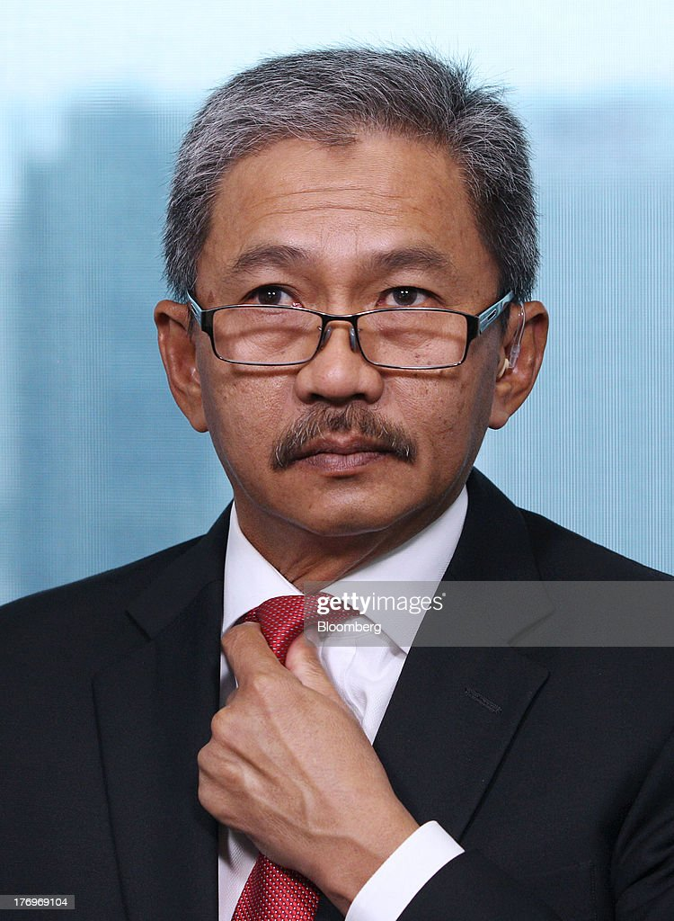 Wan Abdullah Wan Ibrahim, chief executive officer of UEM Sunrise Bhd., adjusts his tie as he sits for a Bloomberg Television interview in Kuala Lumpur, Malaysia, on Tuesday, Aug. 20, 2013. UEM Sunrise, Malaysia's biggest property developer, plans to sell Shariah-compliant debt towards the end of the year for working capital, Wan Abdullah said. Photographer: Goh Seng Chong/Bloomberg via Getty Images