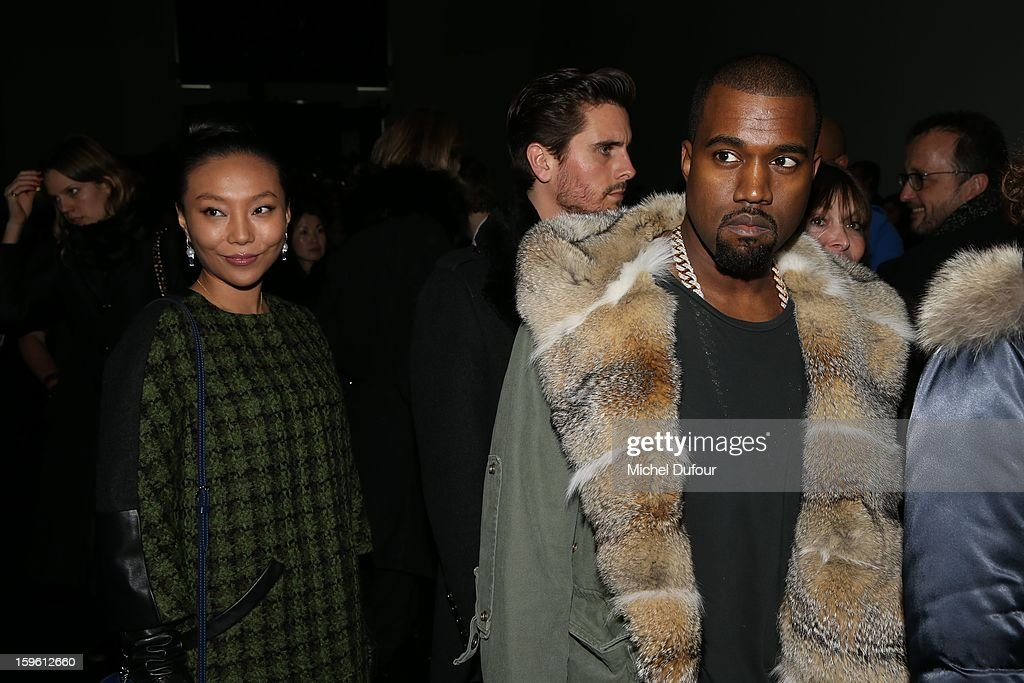 Wan BaoBao and Kanye West attend the Louis Vuitton Men Autumn / Winter 2013 show as part of Paris Fashion Week on January 17, 2013 in Paris, France.