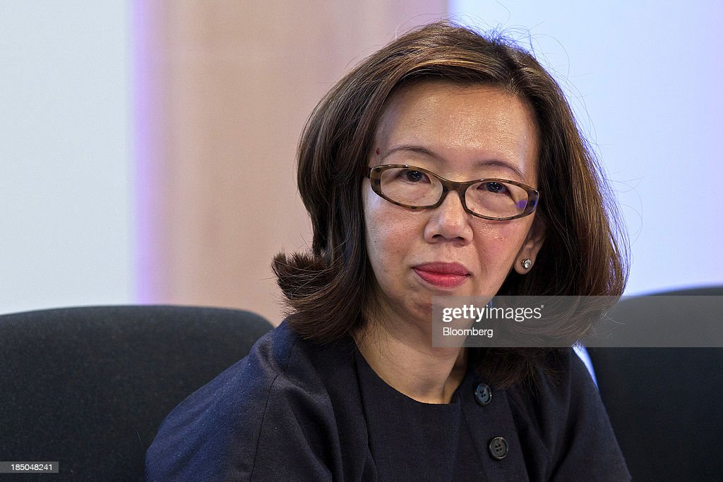 Wan Ling Martello, chief financial officer of Nestle SA, pauses during a news conference to announce the company's results in Vevey, Switzerland, on Thursday, Oct. 17, 2013. Nestle SA, the world's biggest food company, reported nine-month sales that were below its full-year target rate, highlighting the difficult environment faced by the makers of consumer products. Photographer: Gianluca Colla/Bloomberg via Getty Images
