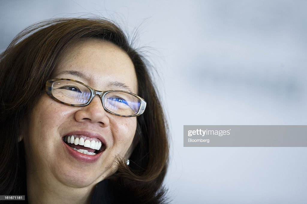 Wan Ling Martello, chief financial officer of Nestle SA, reacts during a news conference to announce the company's annual results in Vevey, Switzerland, on Thursday, Feb. 14, 2013. Nestle SA said it expects 2013 to be as challenging as last year, when sales missed analysts' estimates on a slowdown in emerging markets, a region the world's largest food company is increasingly dependent upon. Photographer: Valentin Flauraud/Bloomberg via Getty Images