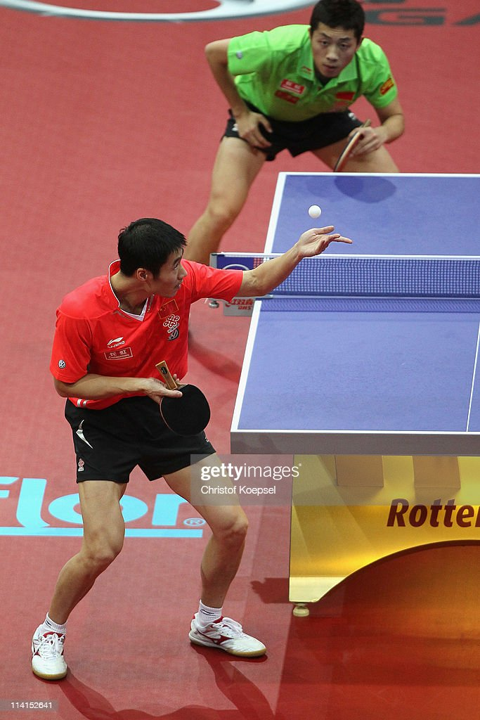 Wan Liqin of China (in front) serves during the Round of 16 Men's Single match between <a gi-track='captionPersonalityLinkClicked' href=/galleries/search?phrase=Wang+Liqin&family=editorial&specificpeople=221536 ng-click='$event.stopPropagation()'>Wang Liqin</a> of China and Xu Xin of China during the World Table Tennis Championships at Ahoy Arena on May 13, 2011 in Rotterdam, Netherlands. <a gi-track='captionPersonalityLinkClicked' href=/galleries/search?phrase=Wang+Liqin&family=editorial&specificpeople=221536 ng-click='$event.stopPropagation()'>Wang Liqin</a> of China won 4-1 against Xu Xin of China.
