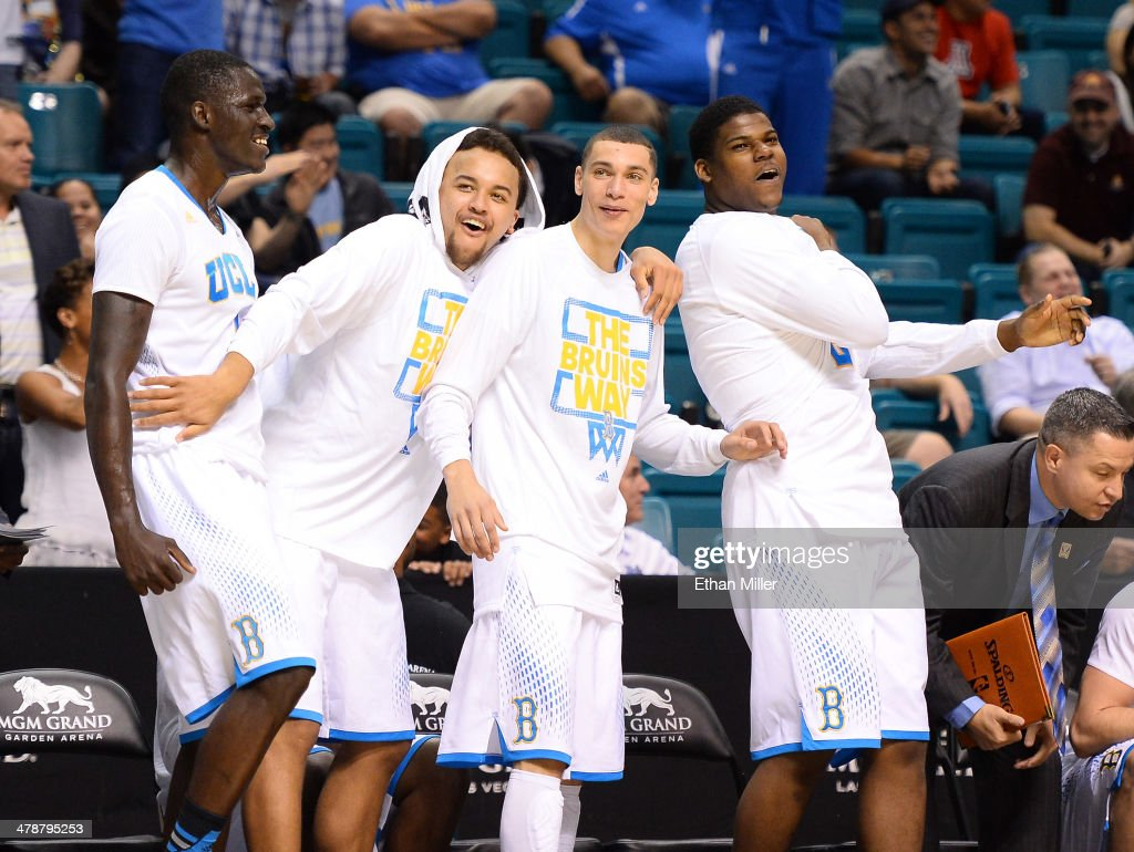 Wanaah Bail #1, Kyle Anderson #5, Zach LaVine #14 and Tony Parker #23 of the UCLA Bruins react to a dunk by teammate Noah Allen late in their semifinal game of the Pac-12 Basketball Tournament against the Stanford Cardinal at the MGM Grand Garden Arena on March 14, 2014 in Las Vegas, Nevada. UCLA won 84-59.