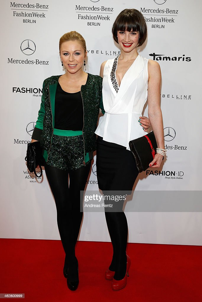 Wanda Badwal (R) arrives for the Marcel Ostertag show during Mercedes-Benz Fashion Week Autumn/Winter 2014/15 at Brandenburg Gate on January 15, 2014 in Berlin, Germany.