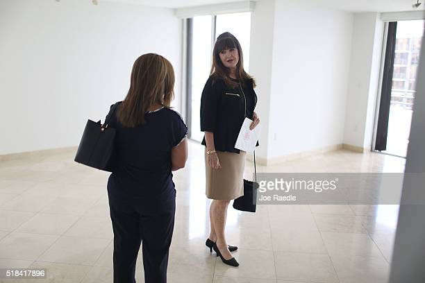 Wanda Bee Real Estate consultant with Re/Max shows a condo to prospective buyer Gioconda VelezBrooks at the Brickell East condos on March 31 2016 in...