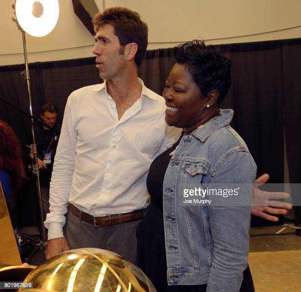 Wanda Durant and Bob Meyers of the Golden State Warriors pose for a photo with the Larry O'Brien Trophy during the postgame celebration after Game...