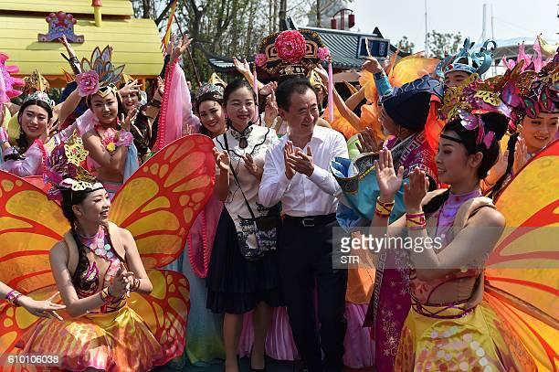 Wanda Group Chairman Wang Jianlin talks to performers at Hefei Wanda Culture Tourism City in Hefei east China's Anhui province on September 24 2016 /...