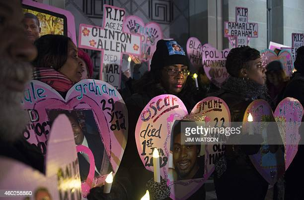 Wanda Johnson whose son Oscar Grant was fatally shot in 2009 by a police officer in Oakland California stands with others during a Mothers Against...