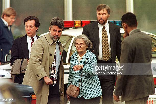 Wanda Kaczynski and her son David Kaczynski are escorted to their car by defense lawyer Dennis Waks and attorney Anthony Pisceglie after the...