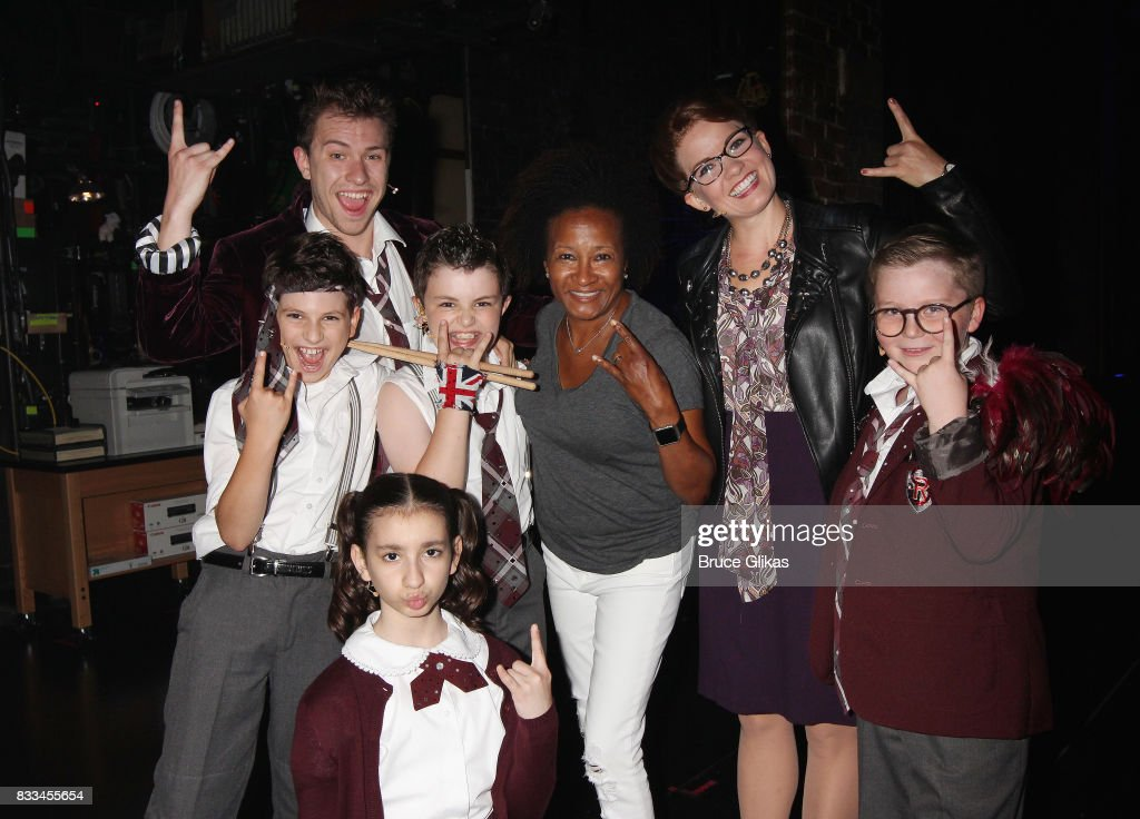 Wanda Sykes poses with the cast backstage at the hit musical 'School of Rock' on Broadway at The Winter Garden Theatre on August 16, 2017 in New York City.