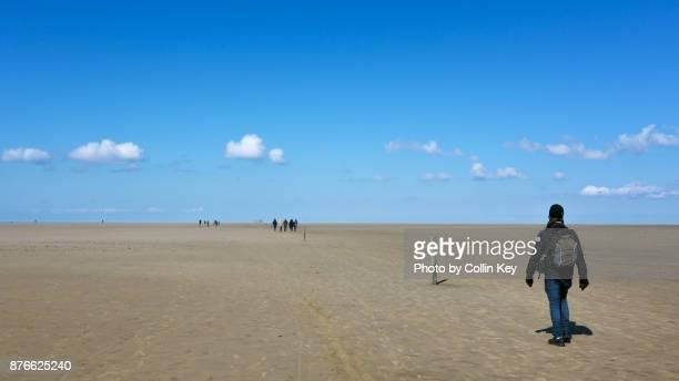 Wanderer unterwegs im Wattenmeer