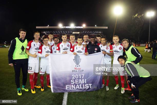 Wanderers celebrate victory in the penalty shoot out during the FFA Cup Quarterfinal match between Blacktown City and the Western Sydney Wanderers at...