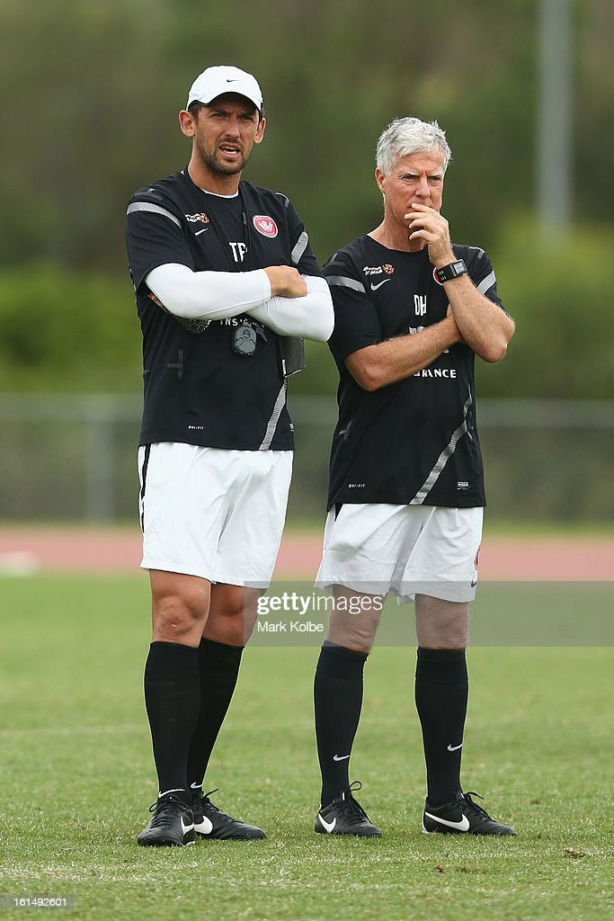 Wanderers coach <a gi-track='captionPersonalityLinkClicked' href=/galleries/search?phrase=Tony+Popovic&family=editorial&specificpeople=213704 ng-click='$event.stopPropagation()'>Tony Popovic</a> and David Hughes watch on during a Western Sydney Wanderers A-League training session at Blacktown International Sportspark on February 12, 2013 in Sydney, Australia.
