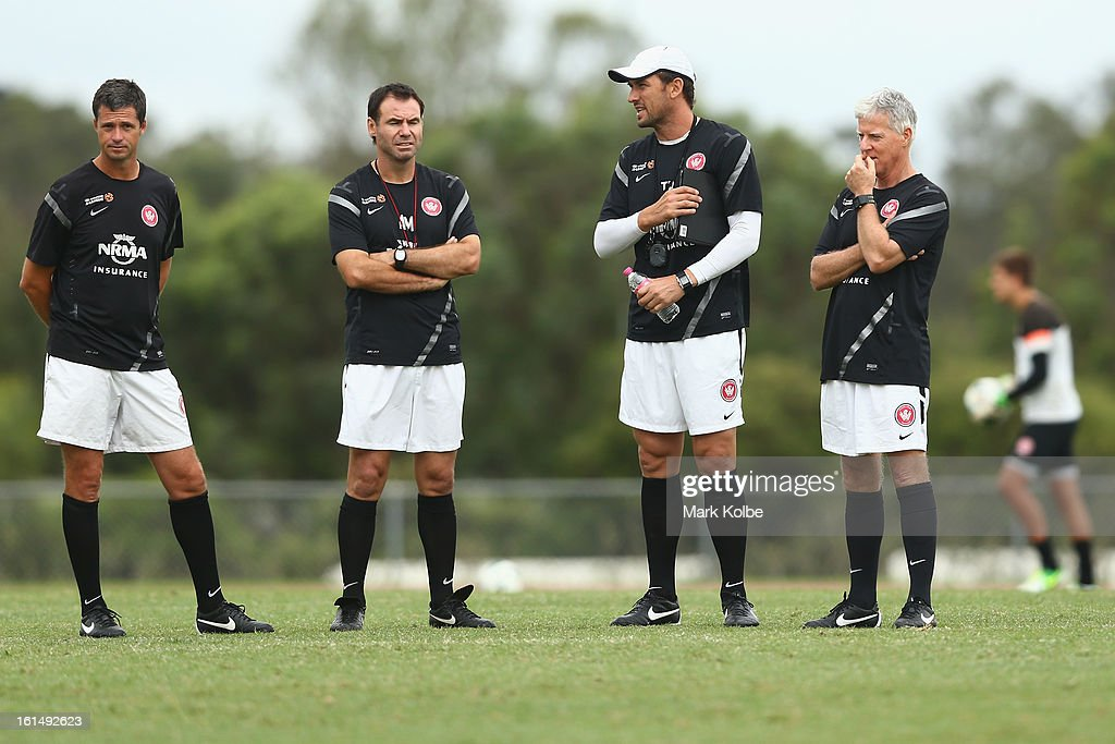 Wanderers coach <a gi-track='captionPersonalityLinkClicked' href=/galleries/search?phrase=Tony+Popovic&family=editorial&specificpeople=213704 ng-click='$event.stopPropagation()'>Tony Popovic</a> and members of the coaching staff watch on during a Western Sydney Wanderers A-League training session at Blacktown International Sportspark on February 12, 2013 in Sydney, Australia.