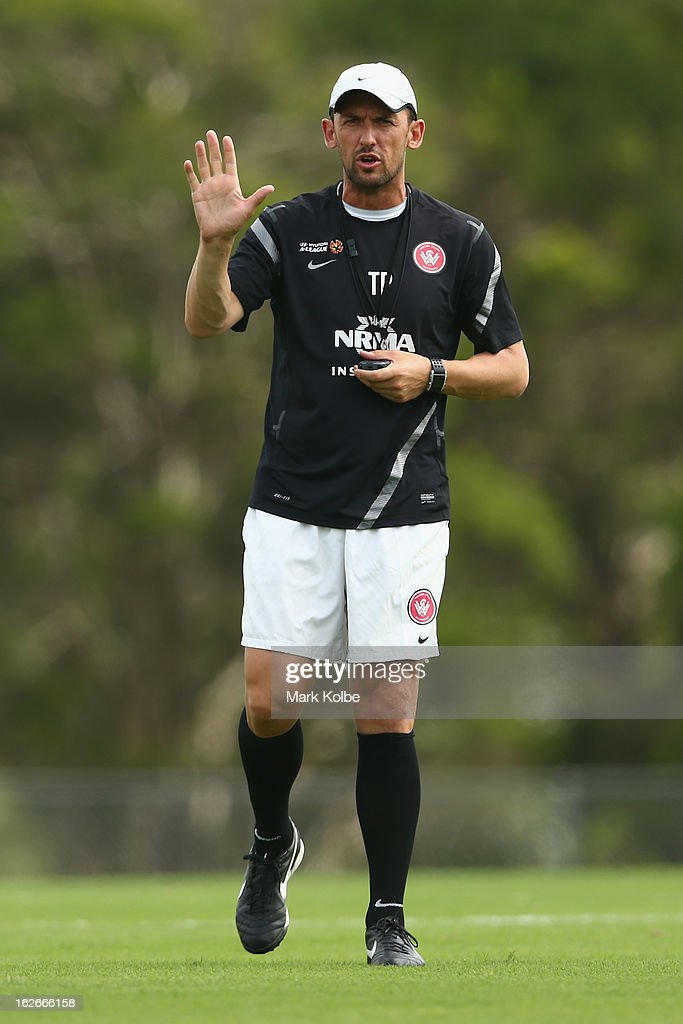 Wanderers coach <a gi-track='captionPersonalityLinkClicked' href=/galleries/search?phrase=Tony+Popovic&family=editorial&specificpeople=213704 ng-click='$event.stopPropagation()'>Tony Popovic</a> gives instructions to his players during a Western Sydney Wanderers A-League training session at Blacktown International Sportspark on February 26, 2013 in Sydney, Australia.