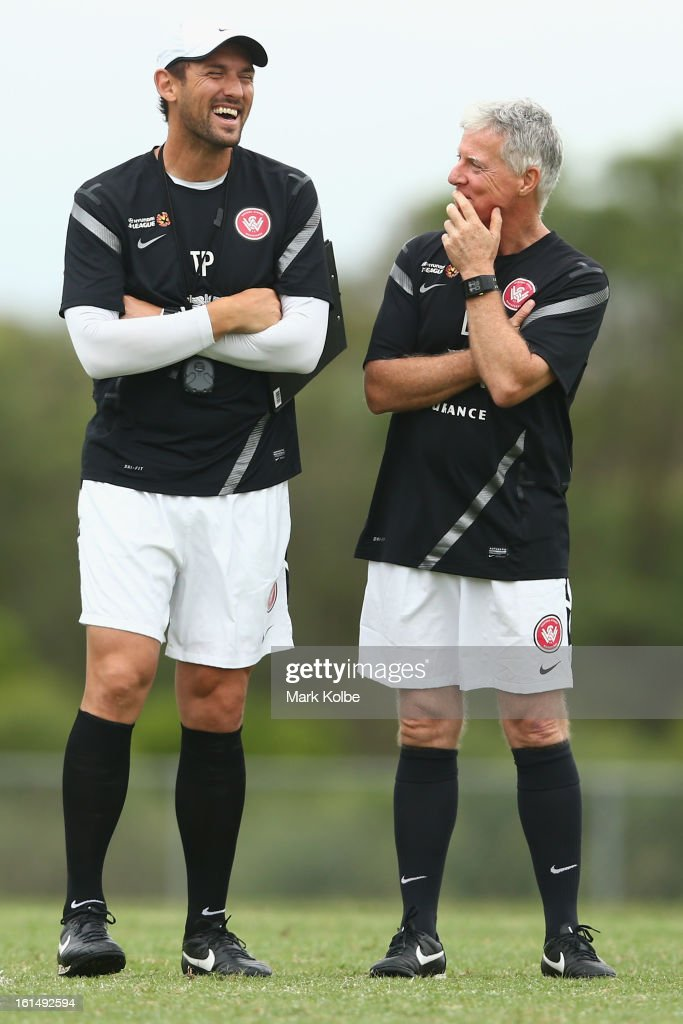 Wanderers coach <a gi-track='captionPersonalityLinkClicked' href=/galleries/search?phrase=Tony+Popovic&family=editorial&specificpeople=213704 ng-click='$event.stopPropagation()'>Tony Popovic</a> shares a joke with a member of his coaching staff David Hughes during a Western Sydney Wanderers A-League training session at Blacktown International Sportspark on February 12, 2013 in Sydney, Australia.