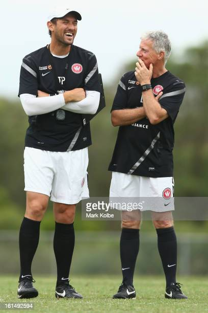 Wanderers coach Tony Popovic shares a joke with a member of his coaching staff David Hughes during a Western Sydney Wanderers ALeague training...