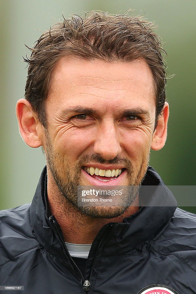 Wanderers coach, <a gi-track='captionPersonalityLinkClicked' href=/galleries/search?phrase=Tony+Popovic&family=editorial&specificpeople=213704 ng-click='$event.stopPropagation()'>Tony Popovic</a> shares a joke with his players during a Western Sydney Wanderers A-League training session at Blacktown International Sportspark on April 16, 2013 in Sydney, Australia.