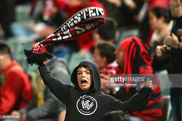 Wanderers fan sings during the Asian Champions League Final match between the Western Sydney Wanderers and Guangzhou Evergrande at Pirtek Stadium on...