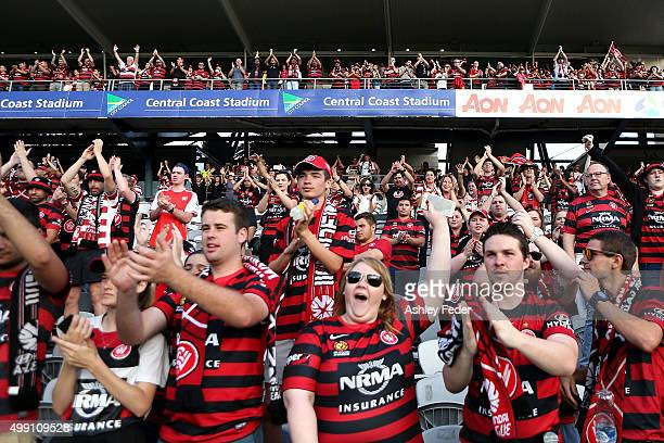 Wanderers fans celebrate during the round eight ALeague match between the Central Coast Mariners and the Western Sydney Wanderers at Central Coast...