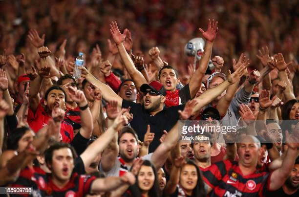 Wanderers fans celebrate during the round three ALeague match between Sydney FC and the Western Sydney Wanderers at Allianz Stadium on October 26...