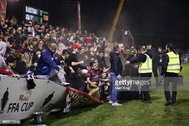 Wanderers fans celebrate the extra time goal to Oriol Riera of the Wanderers as the perimeter fence gives way during the FFA Cup Quarterfinal match...