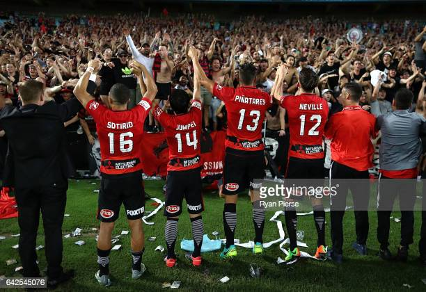 Wanderers fans celebrate with the players after the round 20 ALeague match between the Western Sydney Wanderers and Sydney FC at ANZ Stadium on...