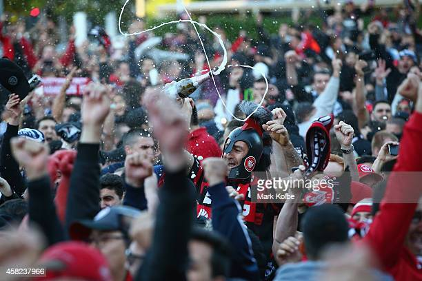 Wanderers fans cheer as they celebrate victory after watching the Asian Champions League final match between Western Sydney Wanders and Al Hilal at...