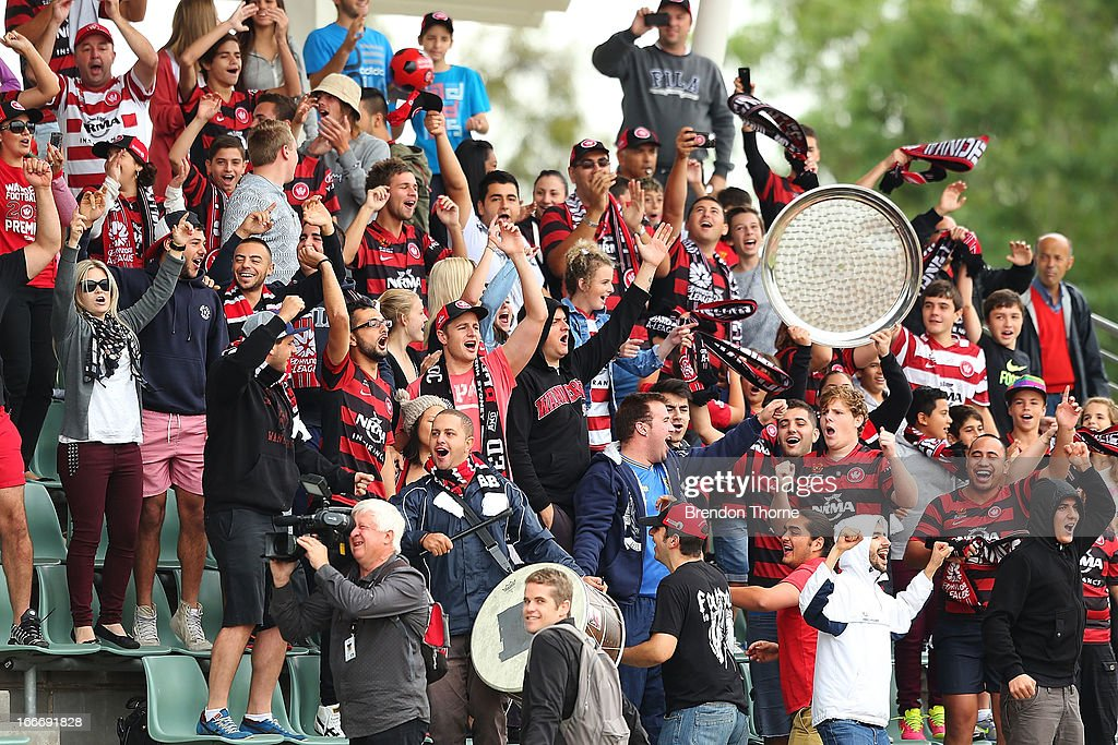 Wanderers fans cheer their team during a Western Sydney Wanderers A-League training session at Blacktown International Sportspark on April 16, 2013 in Sydney, Australia.