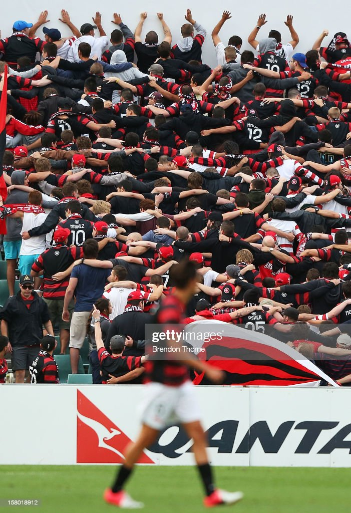 Wanderers fans cheers from the grandstand during the round ten A-League match between the Western Sydney Wanderers and the Brisbane Roar at Parramatta Stadium on December 9, 2012 in Sydney, Australia.