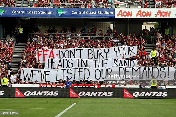 Wanderers fans hold up signs during the round eight ALeague match between the Central Coast Mariners and the Western Sydney Wanderers at Central...