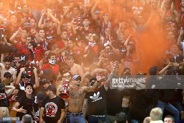 Wanderers fans let off flares during the round 12 ALeague match between Melbourne Victory and the Western Sydney Wanderers at AAMI Park on December...