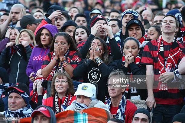 Wanderers fans react after a missed shot on goal as they watch the Asian Champions League final match between Western Sydney Wanders and Al Hilal at...