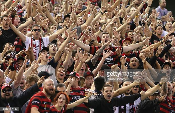 Wanderers fans show their support during the round one ALeague match between Melbourne Victory and the Western Sydney Wanderers at Etihad Stadium on...