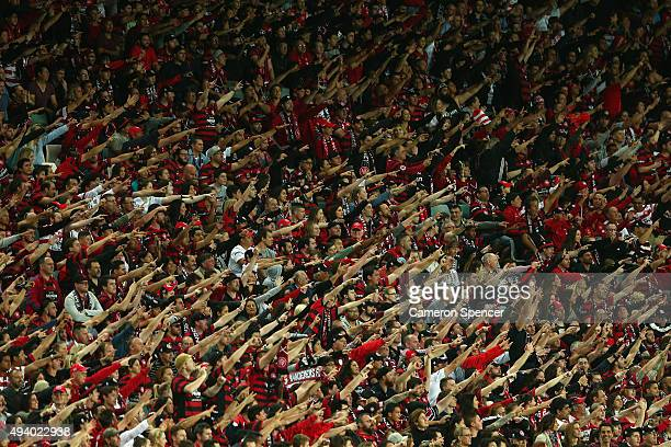Wanderers fans sing during the round three ALeague match between Sydney FC and Western Sydney Wanderers at Allianz Stadium on October 24 2015 in...