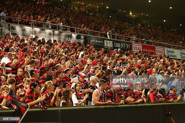 Wanderers fans stand and clap in the 63rd minute as a tribute to the passing of cricketer Phillip Hughes during the round eight ALeague match between...