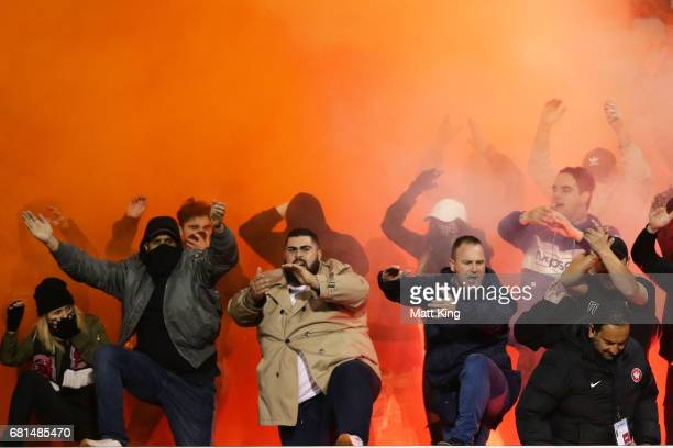 Wanderers fans support after a flare was lit during the AFC Asian Champions League Group Stage match between the Western Sydney Wanderers and...