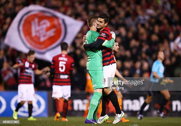 Wanderers goalkeeper Andrew Redmayne celebrates with Daniel Alessi after victory in the FFA Cup match between Western Sydney Wanderers and Brisbane...