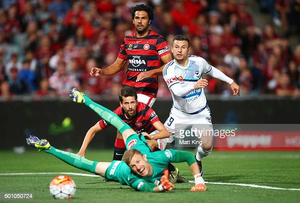Wanderers goalkeeper Andrew Redmayne dives past a shot at goal by Kosta Barbarouses of Melbourne Victory during the round 10 ALeague match between...